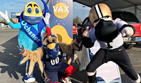 Ollie Ochsner, Pierre Pelican and Sir Saint welcome Vax Fest participants