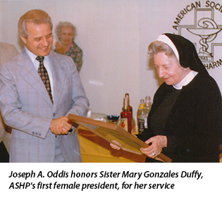 Joseph A. Oddis honors Sister Mary Gonzales Duffy, ASHP's first female president, for her service