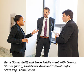 Rena Gösser (left) and Steve Riddle meet with Connor  Stubbs (right), Legislative Assistant to Washington  State Rep. Adam Smith.